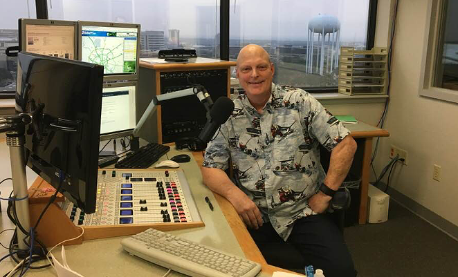 Brent Boller smiles at the mic in Texas Public Radio's studio. - FACEBOOK / BRENT BOLLER