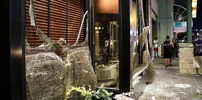 Vandals broke windows and spray painted downtown San Antonio businesses on Saturday night. - JAMES DOBBINS