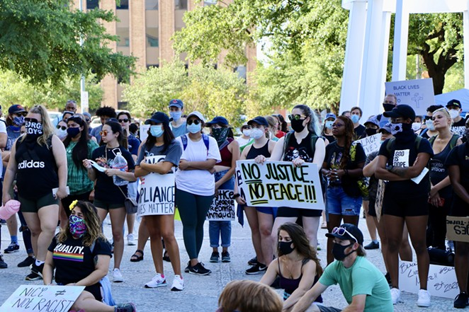 Activists gathered downtown over the weekend listen to a speaker. - JAMES DOBBINS