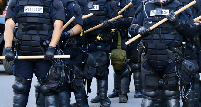 Police in riot gear stand at the ready during the George Floyd protests in San Antonio on Saturday, May 30. - JAMES DOBBINS