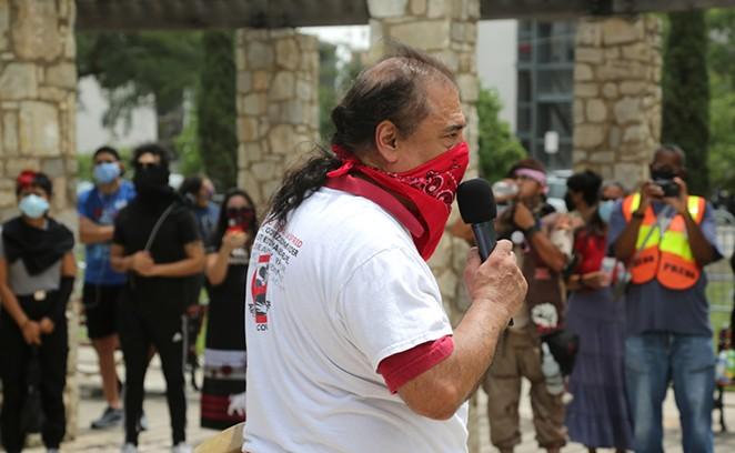 Activist Antonio Diaz addresses the crowd at a recent protest against the statue. - SAN ANTONIO HERON / BEN OLIVO