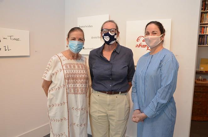 Trinity professor Norma Elia Cantú, artist Ethel Shipton and gallerist Patricia Ruiz-Healy pose in front of Shipton's work at Ruiz-Healy Art. - BRYAN RINDFUSS
