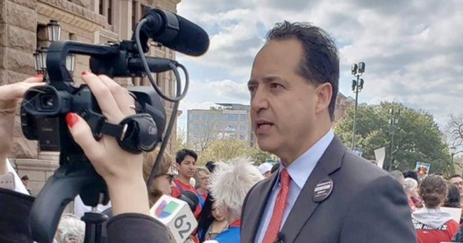 Texas Sen. Jose Menendez speaks to TV news crews outside the state capitol. - TWITTER / JOSE MENENDEZ