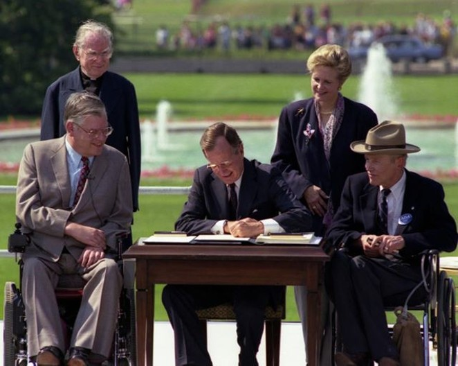 President Bush signs the ADA into law in 1990. - FACEBOOK / ADA NATIONAL NETWORK