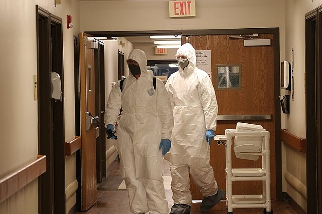 Members of the Texas Army National Guard clean and disinfect nursing home surfaces after a COVID-19 outbreak. - WIKIMEDIA COMMONS / NATIONAL GUARD