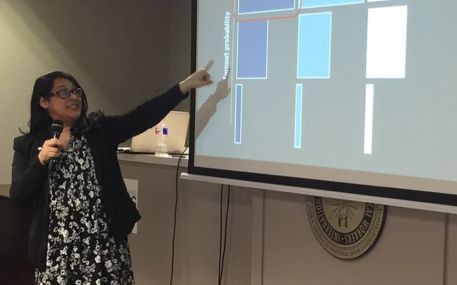 Jenn Longoria shows off campaign volunteer data during a presentation. - INSTAGRAM / JENN LONGORIA