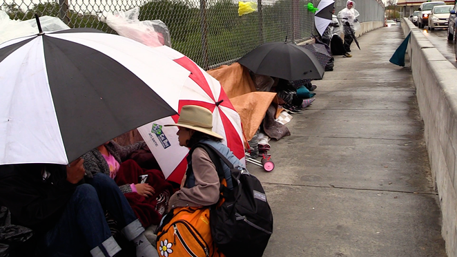 Central American refugees line up in Matamoros to wait for a chance to plead for asylum. - REBECCA CENTENO