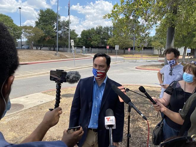U.S. Rep. Joaquin Castro speaks to reporters outside San Antonio's main post office distribution site. - SANFORD NOWLIN