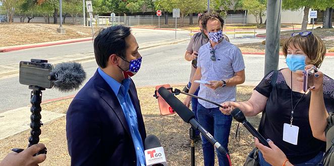 U.S. Rep. Joaquin Castro speaks to reporters outside San Antonio's central mail distribution site. - SANFORD NOWLIN