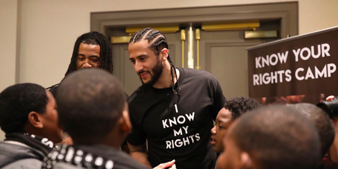 Colin Kaepernick meets with young people at one of his Know Your Rights camps. - TWITTER / @KAEPERNICK7