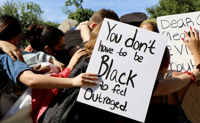 Protesters gather together at a San Antonio Black Lives Matter protest this spring. - JAMES DOBBINS