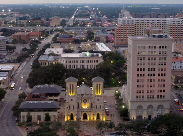 As part of a deal to bring a new skyscraper to downtown San Antonio, the Municipal Plaza Building to the right of the San Fernando Cathedral in this photo will be sold to a developer for residential and retail space. - WIKIMEDIA