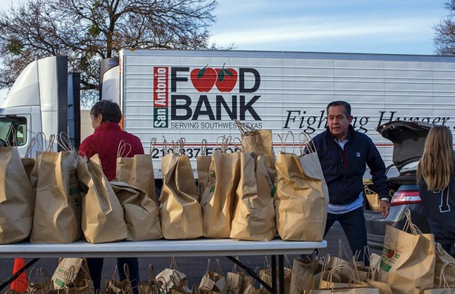 Volunteers work at a San Antonio Food Bank distribution. - INSTAGRAM / SAFOODBANK
