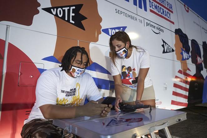 A visitor to Amazon's bus stop in Phoenix registers to vote. - COURTESY PHOTO / AMAZON STUDIOS
