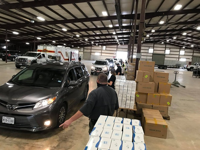 County workers prepare to hand out masks at a distribution event in - FACEBOOK / BEXAR COUNTY, TEXAS