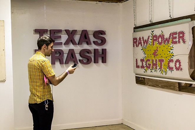 The original  Raw Power and Light Company  sign is part - ALEX RAMIREZ