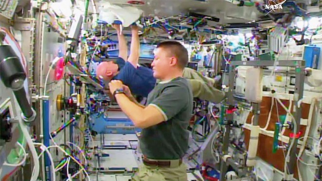 NASA Astronauts Scott Kelly and Kjell Lindgren doing space stuff, no big deal. - NASA TV