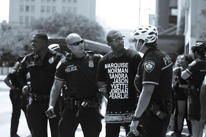 Black Lives Matter activist Mike Lowe disputes portions of arrest report. - DARCELL BIOS