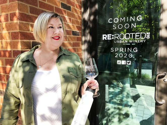 Jennifer Beckmann raises a glass outside of ReRooted 210, which is expected to open next month. - NINA RANGEL