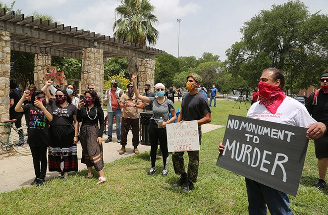 Advocates for the removal of the Christopher Columbus statue protest Saturday, June 27, 2020, at Columbus Park. - BEN OLIVO / SAN ANTONIO HERON