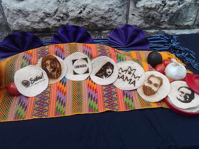 The Convergent Media Collective used a laser to burn images onto tortillas. They hope to raise money for a new laser to use during Luminaria 2015. The plan is to set up a photo booth so people can have their images burned onto tortillas. - PHOTO BY MARK REAGAN