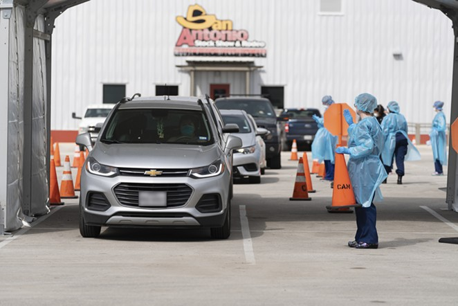 Workers at the Freeman Coliseum coronavirus testing site wave motorists through. - COURTESY PHOTO / SAN ANTONIO FIRE DEPARTMENT
