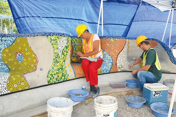 Dedicated workers have set thousands of pieces of glass and porcelain at Yanaguana Garden. - BRYAN RINDFUSS