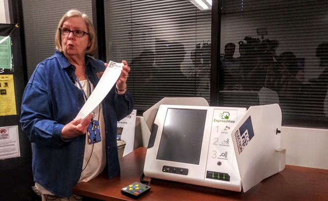 Bexar County Elections Administrator Jacque Callanen demonstrates one of the county's new voting machines during a press event last year. - RHYMA CASTILLO