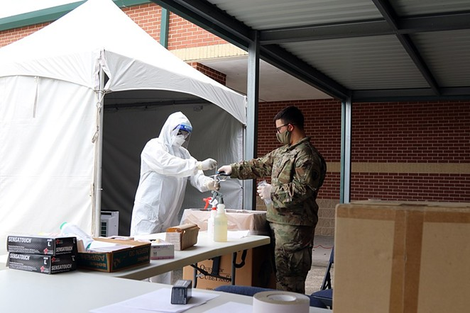 Texas Army National Guard Soldiers process sample bags containing COVID-19 tests. - WIKIMEDIA COMMONS / THE NATIONAL GUARD