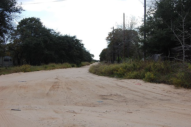 Driving on sandy Highland Oaks streets is a tricky balance. - MICHAEL MARKS