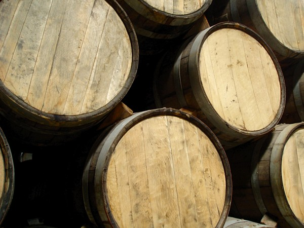 Tequila barrels full of delicious tequila. Smiley face. - WIKIMEDIA