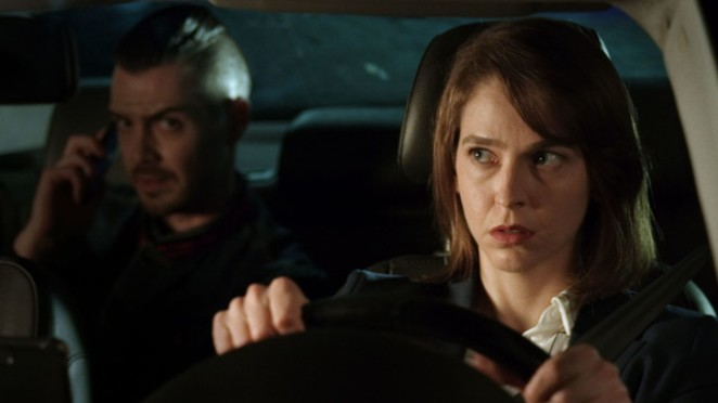 """A driver and her mysterious passenger find their fates entwined in the fantastic thriller, """"Fox Hunt Drive."""" - REBL HQ"""
