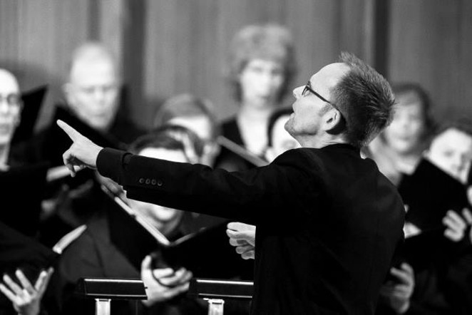 Craig Hella Johnson leading the choir - COURTESY