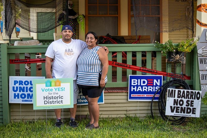 Charley and Rubi Lopez stand in front of their home on Monterey Street. - STEPHANIE MARQUEZ / SA HERON CONTRIBUTOR