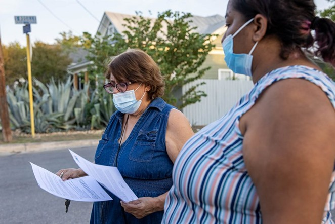 Linda Ortega (left) of the Historic Westside Residents Association talks with Rubi Lopez about the historic district in mid-October. - STEPHANIE MARQUEZ / SA HERON CONTRIBUTOR
