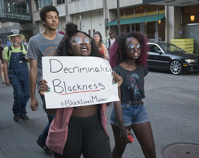 Thirty-two percent of black people killed by police in 2015 were unarmed. - FIBONACCI BLUE/FLICKR