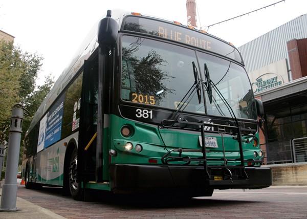 A VIA bus passes The Culinary Institute of America, San Antonio at the Pearl. - VIA METROPOLITAN TRANSIT