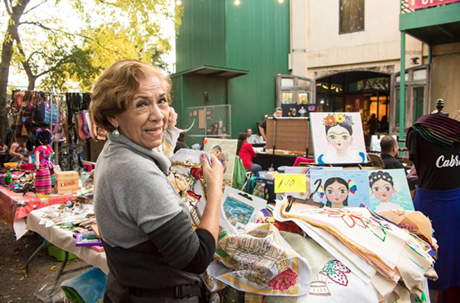 A vendor at a past edition of the Esperanza Center's Mercado de Paz. - COURTESY OF ESPERANZA PEACE AND JUSTICE CENTER