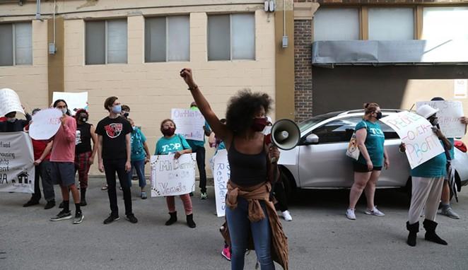 SAHA protestors make their way down South Flores Street on Saturday.