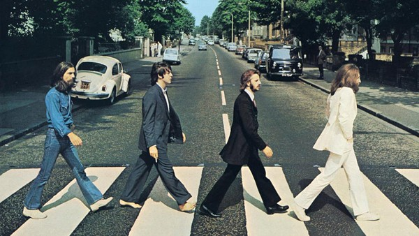 The cover of Abbey Road, said to depict a funeral procession - VIA BIOGRAPHY.COM