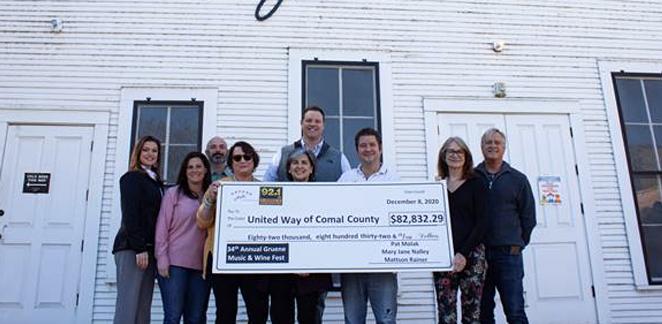 Sponsorship representatives present a check to United Way of Comal County. - COURTESY GRUENE HISTORIC DISTRICT