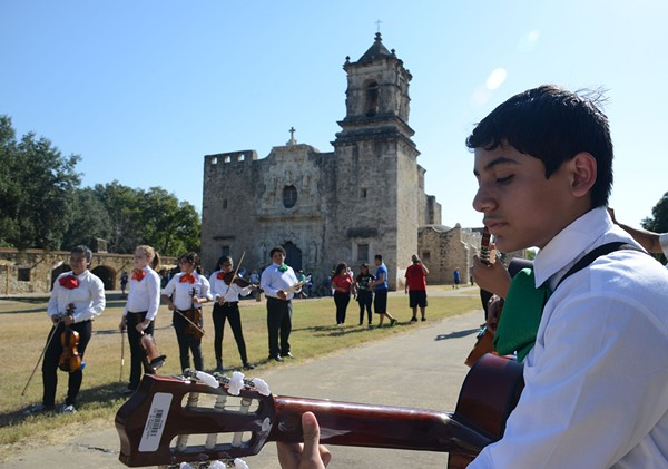 A young guitar player outside Mission San Jose - WIKIMEDIA COMMONS