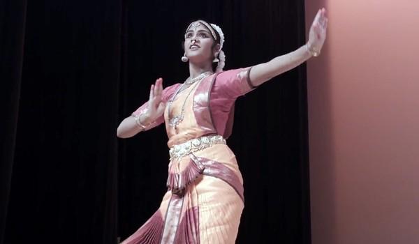 Dance student Gayathri Evani during a bharatanatyam performance in the documentary short Of Gods and Bells. - COURTESY