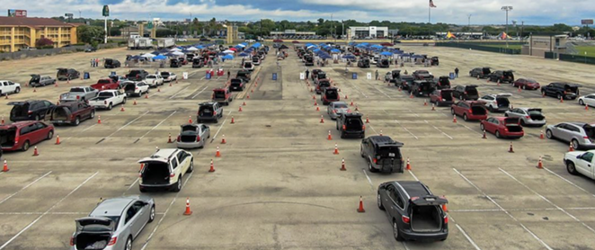 Cars line up for an emergency food distribution in San Antonio. - INSTAGRAM / @SAFOODBANK