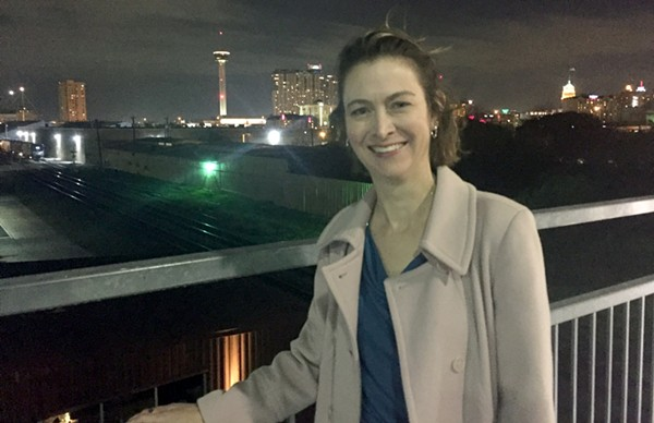 Luminaria executive director Kathy Armstrong takes a moment to enjoy the view from the Hays Street Bridge in Downtown East. Luminaria 2016 will take place in the eastside neighborhood this November.
