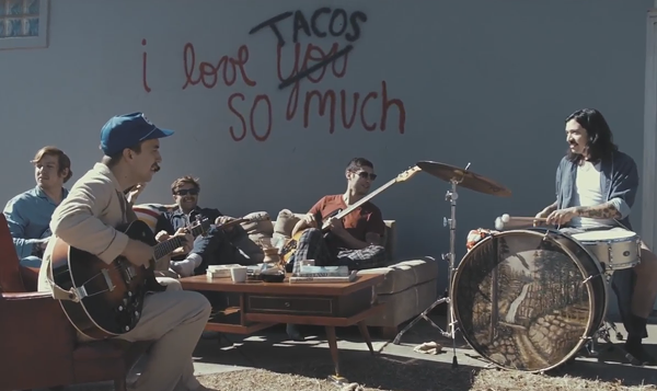 "El Campo at the ""I Love You Tacos So Much"" wall. - YOUTUBE"