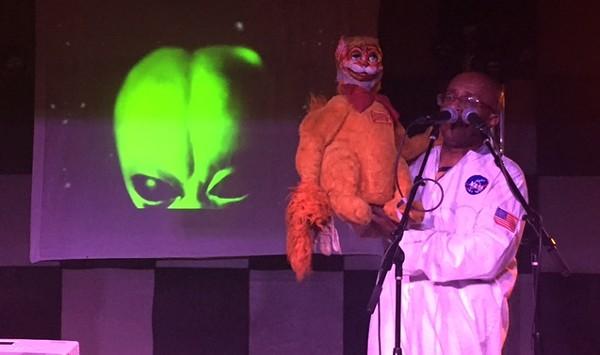 Liebe Hart, Jason the puppet and a peaking alien. - REGINA DE LA GARZA