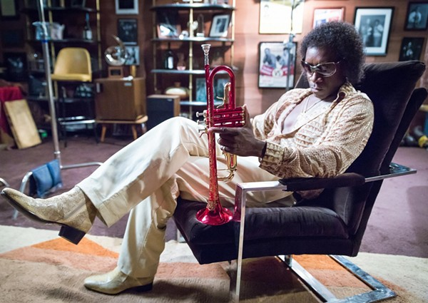 Don Cheadle as jazz trumpeter Miles Davis. - COURTESY