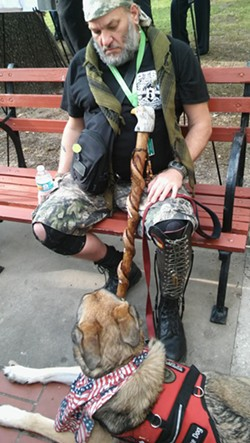 Thomas Riester, a formerly homeless veteran, with his service dog Cooper. Riester receives support for Cooper through Service Dogs Express and Operation at Ease. - MICHAEL MARKS