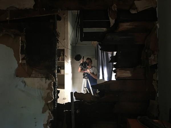 Filmmaker Mark Walley documents the damage inside Casa Chuck - COURTESY WALLEY FILMS